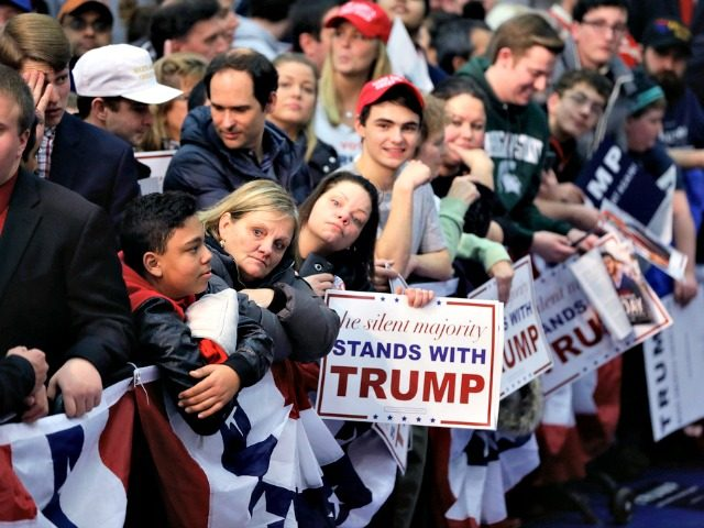 Supporters of Republican presidential candidate, businessman Donald Trump wait for the candidate to walk the line after speaking to a rally at Macomb Community College, Friday, March 4, 2016, in Warren, Mich. (AP Photo/Carlos Osorio)