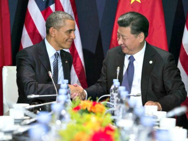 Obama and Chinese President Shake AP
