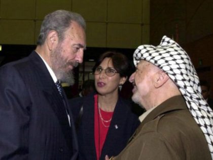 Palestinian leader Yasser Arafat (R) talks with Cuban President Fidel Castro (L) during the opening session of the World Conference Against Racism August 31, 2001 in the coastal city of Durban, South Africa. (Photo by PPO/Getty Images)