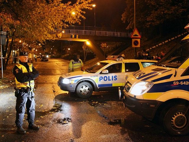 Police secure the area where two immigrant women where shot through an apartment window in Sorbacksgatan in Malmo on October 21, 2010. SCANPIX-SWEDEN/AFP/Getty Images