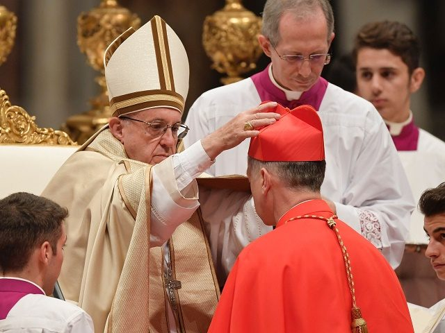 Archbishop of Chicago Blase Joseph Cupich, kneels before Pope Francis to pledge allegiance and become cardinal, on November 19, 2016 during a consistory at Peter's basilica. Pope Francis has named 17 new cardinals, 13 of them under age 80 and thus eligible to vote in a conclave to elect his …