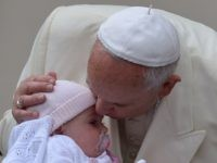 Pope Francis kisses a baby as he arrives for his general audience at St Peter's square on September 24, 2014 at the Vatican. AFP PHOTO / VINCENZO PINTO (Photo credit should read VINCENZO PINTO/AFP/Getty Images)
