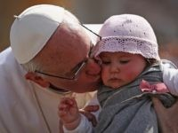 VATICAN CITY, VATICAN - MARCH 24: Pope Francis kisses 8-month-old Victoria Maria Marino from Sicily after delivering his blessing to the palms and to the faithful gathered in St. Peter's Square during Palm Sunday Mass on March 24, 2013 in Vatican City, Vatican. Pope Francis lead his first mass of …