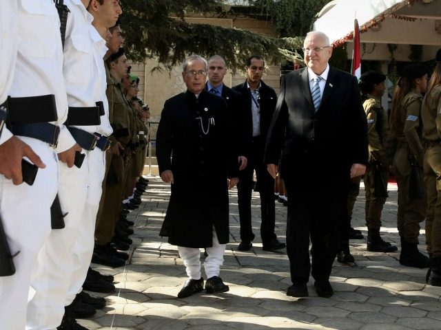 Israeli President Reuven Rivlin (C-R) and his Indian counterpart Pranab Mukherjee (C-L) review the honor guard during a welcoming ceremony at the presidential compound in Jerusalem on October 14, 2015. AFP PHOTO / GALI TIBBON (Photo credit should read GALI TIBBON/AFP/Getty Images)