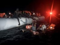 TOPSHOT - Migrants and refugees wait to be rescued from their sinking rubber boat some eight nautical miles off Libya's Mediterranean coastline on October 12, 2016. A growing number of people are attempting the treacherous sea journey from Libya or Egypt, after the closure of the Balkan migrant trail route …