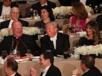 NEW YORK, NY - OCTOBER 20: Sitting between Cardinal Timothy Dolan and his wife Melania Trump, Donald Trump attends the annual Alfred E. Smith Memorial Foundation Dinner at the Waldorf Astoria on October 20, 2016 in New York City.The white-tie dinner, which benefits Catholic charities and celebrates former Governor of …