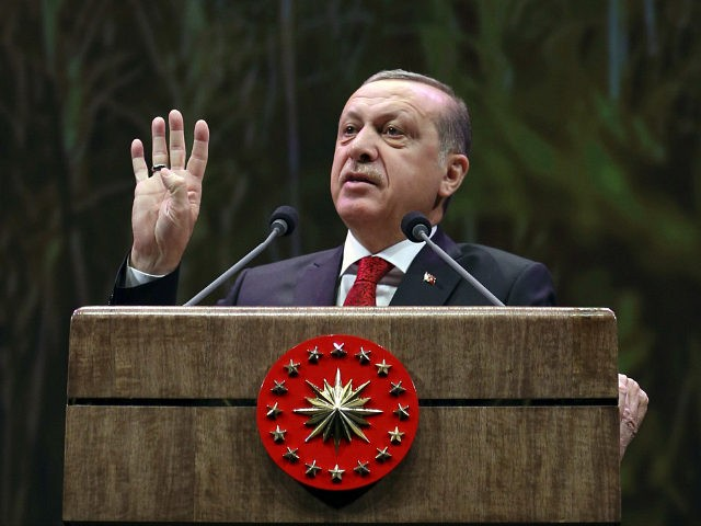 Turkey's President Recep Tayyip Erdogan addresses a group of farmers, in Ankara, Turkey, Monday, Nov. 14, 2016. Erdogan has suggested holding a referendum on the future of Turkey's European Union membership bid amid worsening ties with the union.(Murat Cetinmuhurdar, Presidential Press Service, Pool photo via AP)