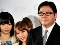 Google vice president Bradley Horowitz (C) smiles with Japanese all-girl pop group AKB48 members Rino Sashihara (L), Minami Takahashi (2nd L), Atsuko Maeda (2nd L) and Mariko Shinoda (L) and AKB48 producer Yasushi Akimoto (3rd L) as they announce plans to expand their reach to the greater Asian market via …