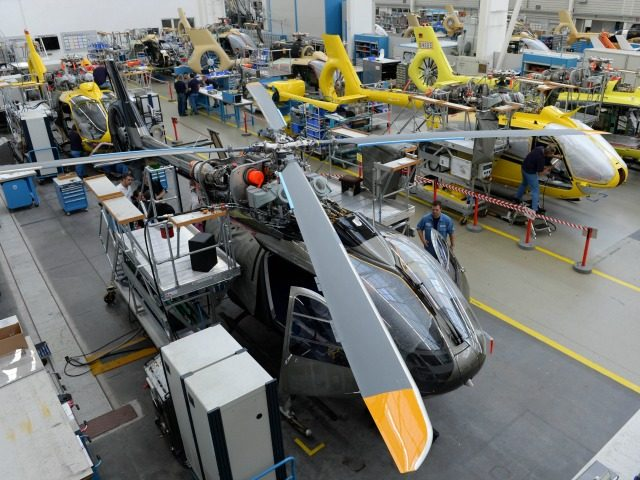 Employees work at the production line of Airbus helicopters at the plant in Donauwoerth, southern Germany, on October 9, 2014. AFP PHOTO/CHRISTOF STACHE (Photo credit should read CHRISTOF STACHE/AFP/Getty Images)
