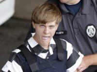 In this Thursday, June 18, 2015, file photo, Charleston, S.C., shooting suspect Dylann Roof is escorted from the Cleveland County Courthouse in Shelby, N.C. The first jurors report to the federal courthouse in Charleston, S.C., on Monday, Sept. 26, 2016 for jury screening in the federal death penalty case charging …