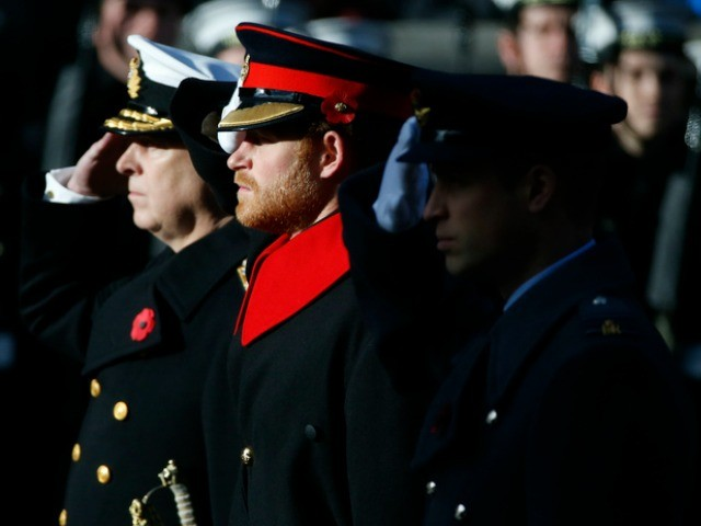Britain's Prince Harry, centre, salutes during the Remembrance Sunday service at the Cenotaph in London, Sunday, Nov. 13, 2016. (AP Photo/Alastair Grant)