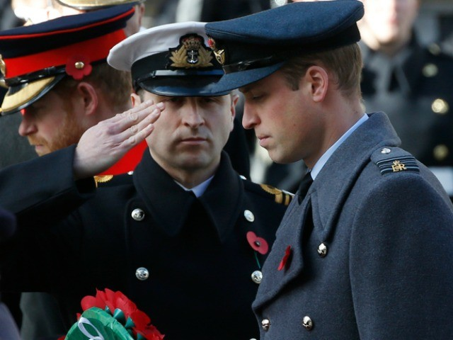 Britain's Prince William is handed his wreath which he will lay on the Cenotaph during the Remembrance Sunday service at the Cenotaph in London, Sunday, Nov.13, 2016. (AP Photo/Alastair Grant)