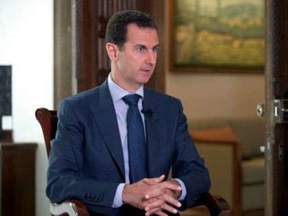 """In this Wednesday, Sept. 21, 2016 photo released by the Syrian Presidency, Syrian President Bashar Assad speaks to The Associated Press at the presidential palace in Damascus, Syria. Assad said U.S. airstrikes on Syrian troops in the country's east were """"definitely intentional,"""" lasting for an hour, and blamed the U.S. …"""