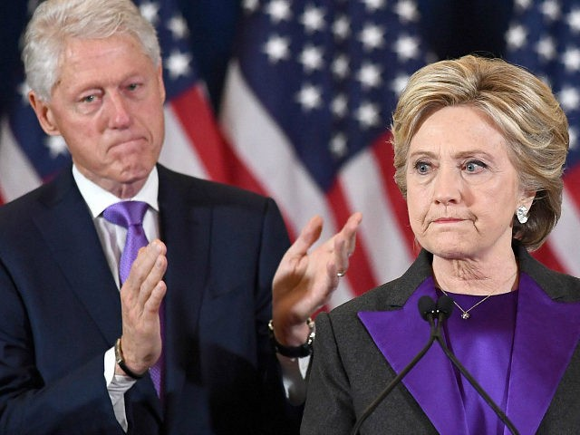 TOPSHOT - US Democratic presidential candidate Hillary Clinton makes a concession speech after being defeated by Republican President-elect Donald Trump, as former President Bill Clinton looks on in New York on November 9, 2016. / AFP / JEWEL SAMAD (Photo credit should read JEWEL SAMAD/AFP/Getty Images)