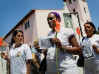 HAVANA, CUBA - MARCH 25: Women with the dissident Ladies in White group, also known as 'Damas de Blanco', march together after a church service a day before Pope Benedict XVI is scheduled to arrive in Cuba on March 25, 2012 in Havana, Cuba. The Ladies in White group are …