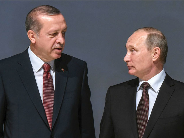 Russian President Vladimir Putin (R) listens to Turkish President Recep Tayyip Erdogan during the 23rd World Energy Congress on October 10, 2016 in Istanbul. Putin visits Turkey on October 10 for talks with counterpart Recep Tayyip Erdogan, pushing forward ambitious joint energy projects as the two sides try to overcome …