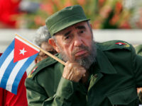 Cuban President Fidel Castro listens to a speaker during the May Day parade in Havana's Revolution Square in this May 1, 2005 file photo. REUTERS/Claudia Daut/File Photo