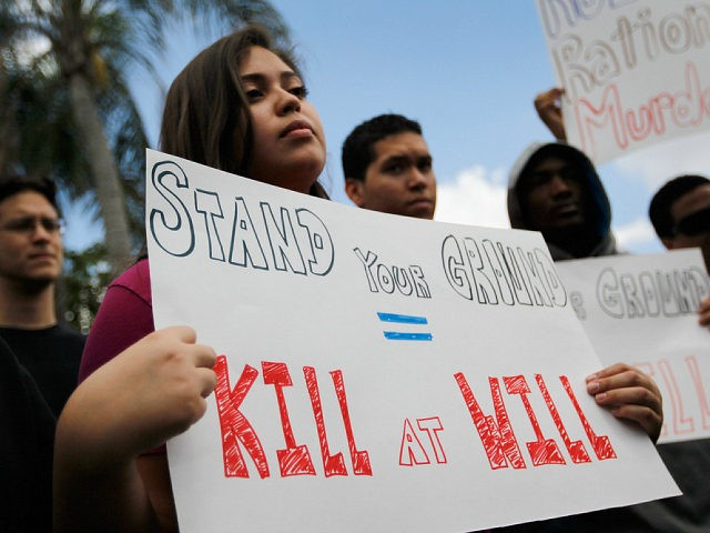 MIAMI, FL - APRIL 09: Grace Miranda and other supporters of Trayvon Martin gather for a rally in front of Florida Senator Marco Rubio's (R-FL) office to ask him to retract his support for Florida's so called 'Stand Your Ground' gun law following the Trayvon Martin killing on April 9, …