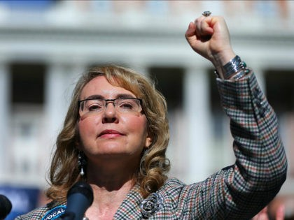 BOSTON - OCTOBER 14: Congresswoman Gabrielle Giffords raises he fist as she addresses a crowd during a rally for gun reforms on Boston Common on Oct. 14, 2016. (Photo by John Tlumacki/The Boston Globe via Getty Images)