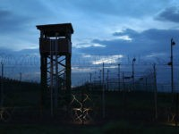 GUANTANAMO BAY, CUBA - OCTOBER 22: (EDITORS NOTE: Image has been reviewed by the U.S. Military prior to transmission.) Razor wire and a guard tower stands at a closed section of the U.S. prison at Guantanamo Bay, also known as 'Gitmo' on October 22, 2016 at the U.S. Naval Station at Guantanamo Bay, Cuba. The U.S. military's Joint Task Force Guantanamo is holding 60 detainees at the prison, down from a previous total of 780. In 2008 President Obama issued an executive order to close the prison, which has failed because of political opposition in the U.S. (Photo by John Moore/Getty Images)