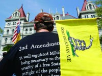 Brandon Oathout of Johnstown, N.Y., attends a Second Amendment rally at the Capitol on Tuesday, May 21, 2013, in Albany, N.Y. A few hundred people gathered for the rally pressing for repeal of the state's new tough laws that were enacted a month after the Newtown, Ct., school massacre. (AP Photo/Mike Groll)