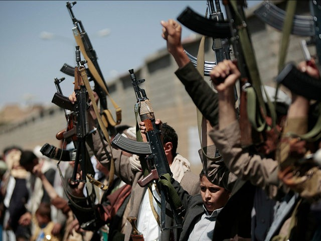 FILE -- In this Sunday, Oct. 2, 2016 file photo, tribesmen loyal to Houthi rebels hold their weapons as they chant slogans during a gathering aimed at mobilizing more fighters into battlefronts in several Yemeni cities, in Sanaa, Yemen. Yemen's civil war is threatening to further entangle the United States …
