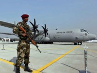 FILE- In this Feb. 5, 2011 file photo, a Special Forces commando stands guard near the C-130J-30 Super Hercules aircraft that it inducted into its transportation fleet, at a ceremony at the Air Force Station at Hindon near New Delhi, India. India is beefing up its defenses with new infantry …