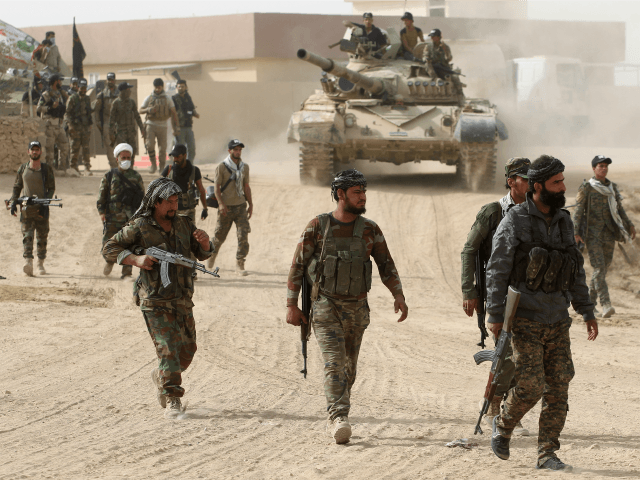 Shiite fighters from the Hashed al-Shaabi (Popular Mobilisation Units) enter the village of Abu Shuwayhah, south of jihadist-held Mosul, on November 1, 2016, during the ongoing operation to retake the last major Islamic State (IS) group stronghold in Iraq. Just over two weeks into the massive offensive to retake Mosul …