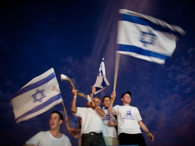 Supporters of freed Israeli soldier Gilad Shalit celebrate on his arrival to his home on October 18, 2011 in Mitzpe Hila, Israel. Shalit was freed after being held captive for five years in Gaza by Hamas militants, in a deal which saw Israel releasing more than 1,000 Palestinian prisoners. (Photo …
