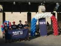 US Marc Zell (2nd L), the chairman of Republicans living in Israel, talks while youths hold a banner reading 'Trump' (Donald) in Hebrew as the Israeli branch of the US Republican party started its first ever election campaign in the central Israeli city of Modiin, on August 15, 2016. / …