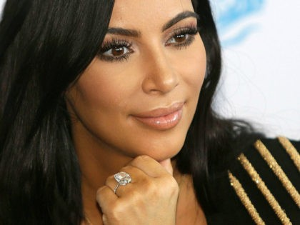 FILE - In this June 24, 2015 file photo, American TV personality Kim Kardashian attends the Cannes Lions 2015, International Advertising Festival in Cannes, southern France. Armed robbers forced their way into a private Paris residence where Kardashian West was staying, and stole more than $10 million worth of jewelry, …