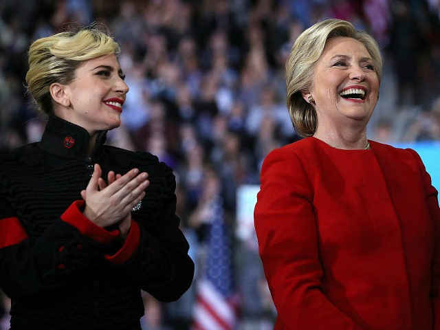 RALEIGH, NC - NOVEMBER 08: Democratic presidential nominee former Secretary of State Hillary Clinton (R) and Lady Gaga smile during a campaign rally at North Carolina State University on November 8, 2016 in Raleigh North Carolina. With less than 24 hours until Election Day in the United States, Hillary Clinton is campaigning in Pennsylvania, Michigan and North Carolina. (Photo by Justin Sullivan/Getty Images)