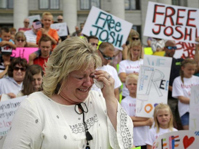 FILE - In this July 30, 2016, file photo, Laurie Holt, the mother of Joshua Holt, an American jailed in Venezuela, cries during a rally at the Utah State Capitol, in Salt Lake City. At a press conference Tuesday, Oct. 11 attorney Jeanette Prieto said Holt was stripped naked and made to perform exercises in a hallway. She said the mistreatment violated international treaties. (AP Photo/Rick Bowmer, File)