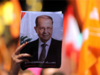 Lebanese celebrate the election for president of Michel Aoun (portrait), a former general backed by the powerful Hezbollah movement as well as longtime rivals, in downtown Beirut on October 31, 2016. Lebanese lawmakers ended a two-year political vacuum by electing as president ex-army chief Michel Aoun, who promised to protect …