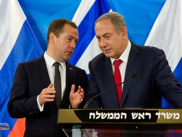 Israeli Prime Minister Benjamin Netanyahu (R) listens to his Russian counterpart Dmitry Medvedev as they deliver joint statements following their meeting in Jerusalem, on November 10, 2016. / AFP / POOL / HEIDI LEVINE (Photo credit should read HEIDI LEVINE/AFP/Getty Images)