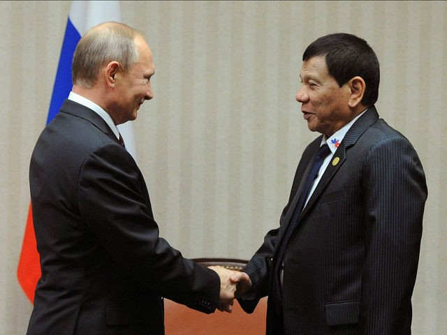 2976703 11/19/2016 November 19, 2016. Russian President Vladimir Putin and Philippine President Rodrigo Duterte during a meeting on the sidelines of the APEC summit in Lima. Michael Klimentyev/Sputnik via AP