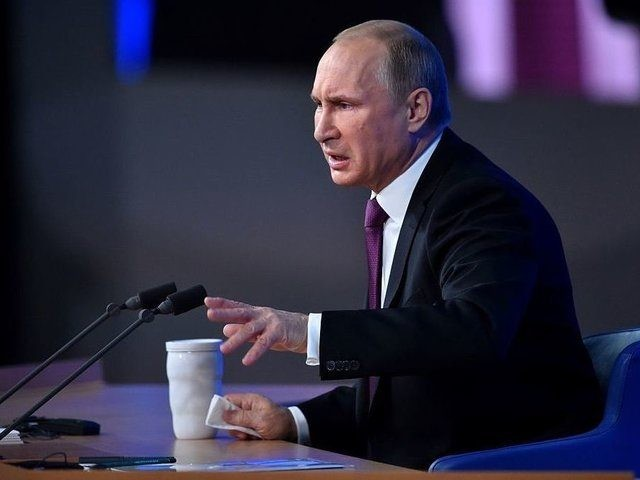 Russian President Vladimir Putin gestures as he speaks during his annual press conference in Moscow on December 18, 2014. Putin crushed Chechnya's rebellion, pushed back Russia's frontiers and restored the pride of a nation humiliated by the demise of the Soviet Union. But 15 years after he came to power …