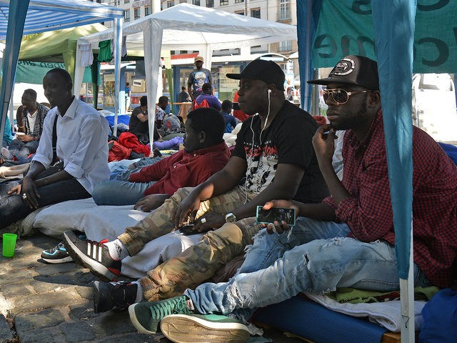 MUNICH, GERMANY - SEPTEMBER 13: Migrants and refugees protesting against deportation and for better conditions camp out next to Sendlinger Tor city gate on September 13, 2016 in Munich, Germany. Approximately 50 men from countries including Pakistan and Congo are threatening to launch a hunger strike if their demand to …