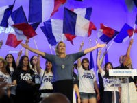 French far-right Front National (FN) party's President, Marine Le Pen, acknowledges the audience on stage during the FN's summer congress in Frejus, southern France, on September 18, 2016. / AFP / Franck PENNANT (Photo credit should read FRANCK PENNANT/AFP/Getty Images)