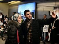 Houda and her husband take a selfie at the airport in Athens before boarding a special charter plane bound for France in the frames of the EU relocation program for refugees on November 3, 2016. The group consisted of 168 mainly Syrian families, Iraqis and Eritreans, including 58 small children. …