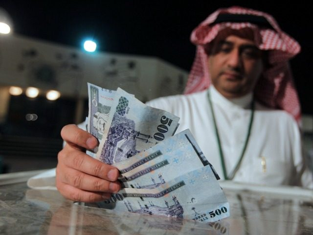 A Saudi man donates money for the Syrian people in Riyadh in the early hours of July 24, 2012. Saudi Arabia collected nearly $32.5 million on the first day of a fundraising campaign the kingdom has launched in support of people in Syria, where an uprising against the regime has …