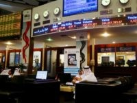 Traders sit at the Dubai bourse as prices of shares are reflected on screens in red above them on January 17, 2016 Share prices in the energy-rich Gulf states nosedived following the sharp decline in oil prices and the expected rise in Iranian crude exports after the sanctions imposed on …