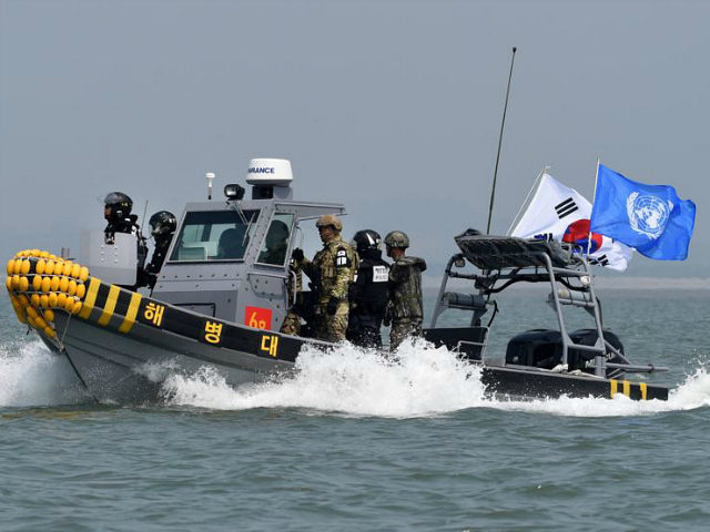 GANGHWA, SOUTH KOREA - JUNE 10: In this handout photo provided by the South Korean Defense Ministry, South Korean marines and navy soldiers on a boat conduct a crackdown against China's illegal fishing in neutral waters on June 10, 2016 in Ganghwa island, South Korea. South Korea sent military vessels …