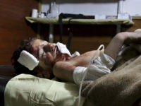 This photo provided by the Unified Medical Bureau of Eastern Ghouta, an opposition activist-run civil society organization, which has been authenticated based on its contents and other AP reporting, shows a boy receiving treatment at a hospital in Ghouta, an opposition-controlled suburb of the capital, Damascus, Sunday, Nov. 6, 2016. The locally-run Education Directorate said government forces struck a school in Ghouta during the first recess of the day. It said more than 25 children were wounded and at least six were killed. (Unified Medical Bureau of Eastern Ghouta via AP)