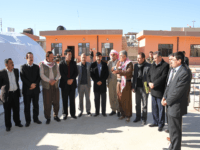 Sinjar Mayor Mahma Khalil Qasim near the middle with scarf around his neck.
