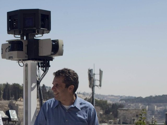 Meir Brand, the managing director of Google Israel, pose with a camera mounted on a tricycle overlooking Jerusalem's Old City during a press conference on September 12, 2011, after the justice ministry gave the go-ahead for Google Street View to start photographing streets in Israel to put on its 3D-mapping …