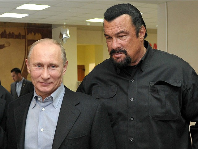 FILE - In this file photo taken on Wednesday, March 13, 2013, Russian President Vladimir Putin, left, and U.S. movie actor Steven Seagal visit a new sports arena in Moscow, Russia. file photo, Russian President Vladimir Putin, right, speaks with U.S. actor Steven Seagal in the Russian Far Eastern port …
