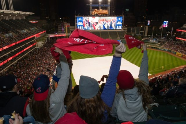 Fans celebrates during the Cleveland Indians World Series Watch Party at Progressive Field on October 30, 2016 in Cleveland, Ohio