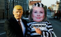Supporters of Republican presidential nominee Donald Trump dressed as US Democratic presidential nominee Hillary Clinton (R) and Trump show their support to the Republican candidate in Allentown, Pennsylvania on November 2, 2016