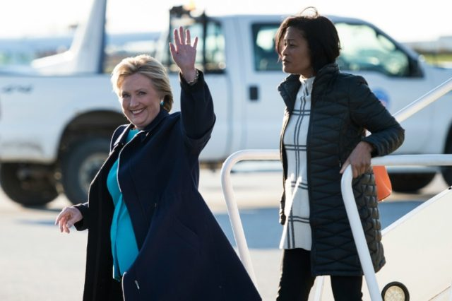 Democratic presidential nominee Hillary Clinton (L) arrives at Cleveland Burke Lakefront Airport November 6, 2016 in Cleveland, Ohio